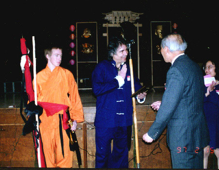 Buddha Zhen with Monk Spade accepting award from Chinese Association President.